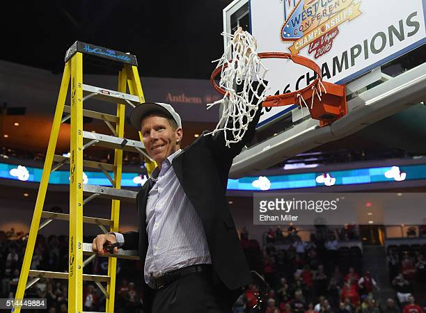 Head coach Mark Few of the Gonzaga Bulldogs holds up a basketball net after cutting it down following his team's 8575 victory over the Saint Mary's...