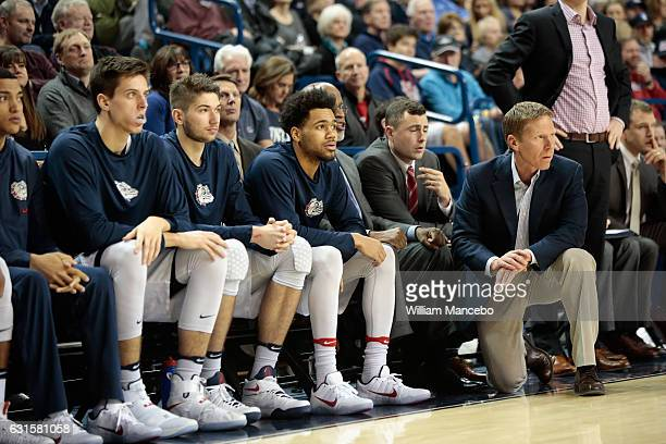 Head coach Mark Few of the Gonzaga Bulldogs looks on from the sideline with players Zach Collins Killian Tillie and Silas Melson during the second...