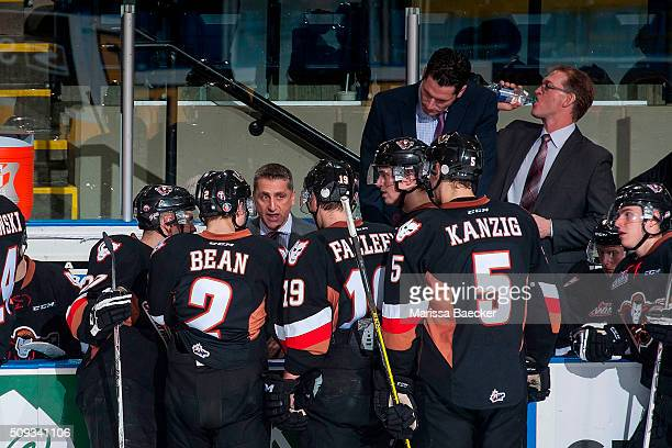 Head coach Mark French of Calgary Hitmen speaks to players on the bench during intermission against the Kelowna Rockets on February 6 2016 at...