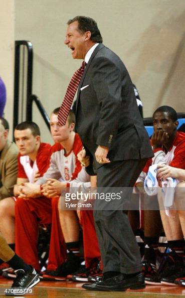 Head Coach Mark Gottfried of the NC State Wolfpack calls out to his players during the game against the Clemson Tigers at Littlejohn Coliseum on...