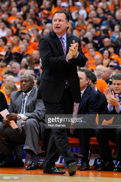 Head coach Mark Gottfried of the North Carolina State Wolfpack cheers for his team against the Syracuse Orange during the first half at the Carrier...