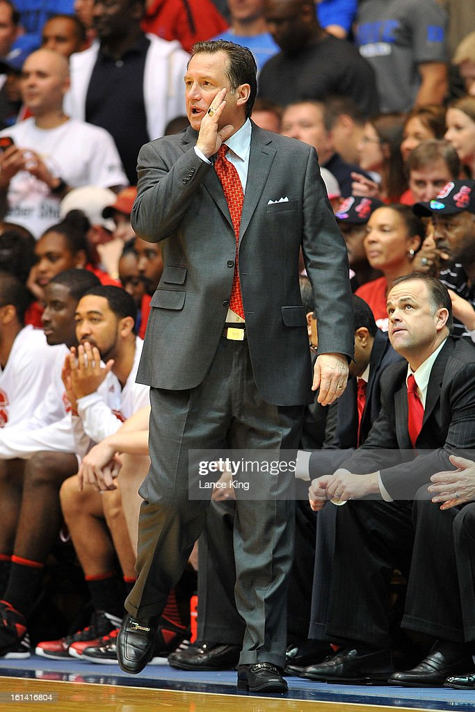 Head Coach Mark Gottfried of the North Carolina State Wolfpack instructs his team from the sideline during a game against the Duke Blue Devils at Cameron Indoor Stadium on February 7, 2013 in Durham, North Carolina. Duke defeated NC State 98-85.