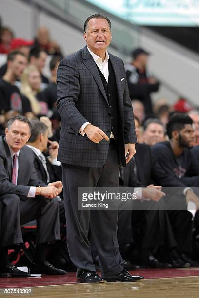 Head coach Mark Gottfried of the North Carolina State Wolfpack directs his team against the Louisville Cardinals at PNC Arena on January 7 2016 in...