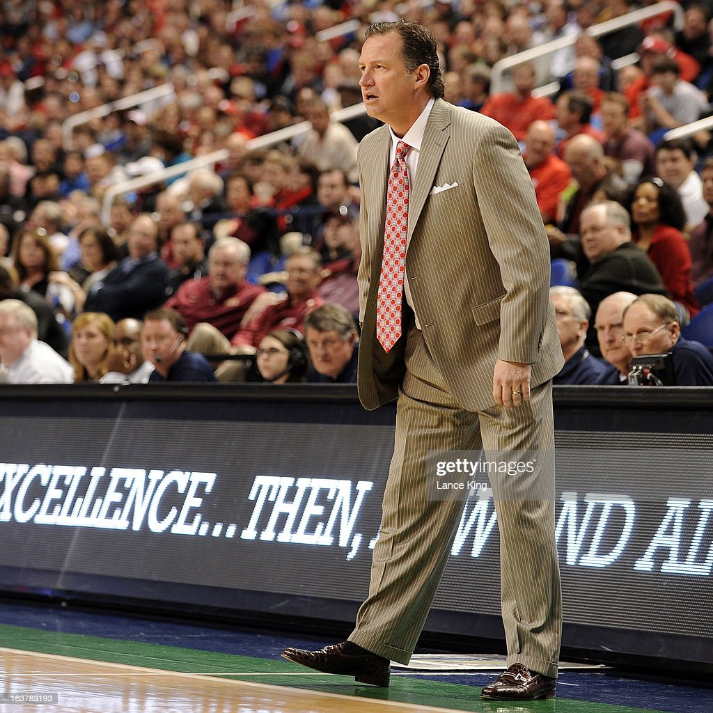 Head Coach Mark Gottfried of the North Carolina State Wolfpack looks on during a game against the Virginia Tech Hokies during the first round of the 2013 Men's ACC Tournament at the Greensboro Coliseum on March 14, 2013 in Greensboro, North Carolina. NC State defeated Virginia Tech 80-63.