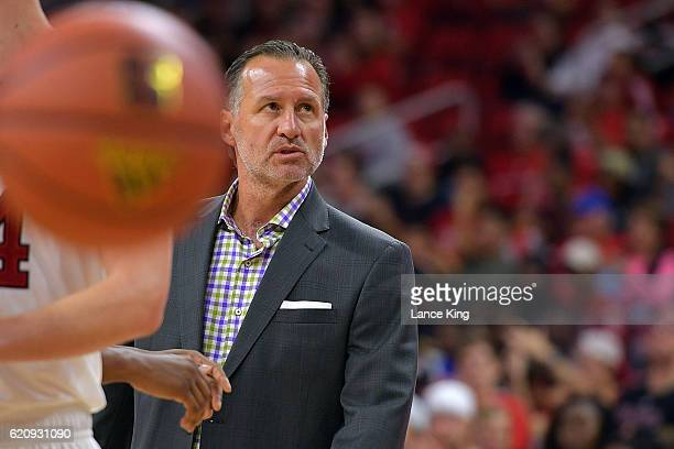 Head coach Mark Gottfried of the North Carolina State Wolfpack looks on during their game against the Lynn Fighting Knights at PNC Arena on November...