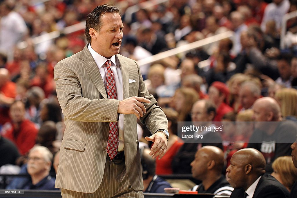 Head Coach Mark Gottfried of the North Carolina State Wolfpack reacts during a game against the Virginia Tech Hokies during the first round of the 2013 Men's ACC Tournament at the Greensboro Coliseum on March 14, 2013 in Greensboro, North Carolina. NC State defeated Virginia Tech 80-63.
