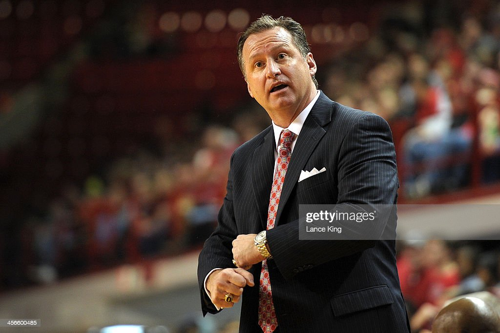 Head Coach <a gi-track='captionPersonalityLinkClicked' href=/galleries/search?phrase=Mark+Gottfried&family=editorial&specificpeople=801295 ng-click='$event.stopPropagation()'>Mark Gottfried</a> of the North Carolina State Wolfpack reacts against the Detroit Titans at Reynolds Coliseum on December 14, 2013 in Raleigh, North Carolina.