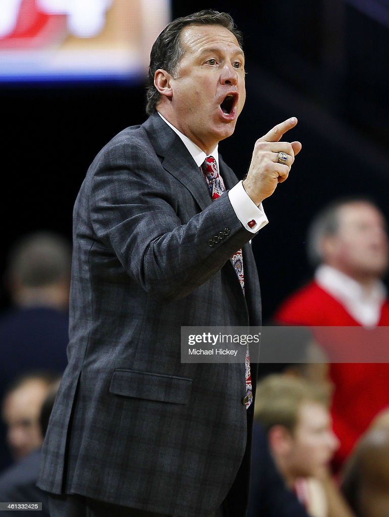Head coach <a gi-track='captionPersonalityLinkClicked' href=/galleries/search?phrase=Mark+Gottfried&family=editorial&specificpeople=801295 ng-click='$event.stopPropagation()'>Mark Gottfried</a> of the North Carolina State Wolfpack reacts on the sidelines during the game against the Notre Dame Fighting Irish at Purcel Pavilion on January 7, 2014 in South Bend, Indiana. North Carolina State defeated Notre Dame 77-70.