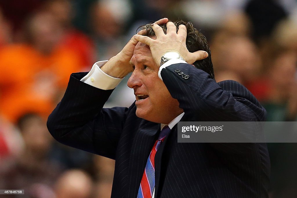 Head coach <a gi-track='captionPersonalityLinkClicked' href=/galleries/search?phrase=Mark+Gottfried&family=editorial&specificpeople=801295 ng-click='$event.stopPropagation()'>Mark Gottfried</a> of the North Carolina State Wolfpack reacts against the Louisville Cardinals in the second half of the game during the East Regional Semifinal of the 2015 NCAA Men's Basketball Tournament at the Carrier Dome on March 27, 2015 in Syracuse, New York.