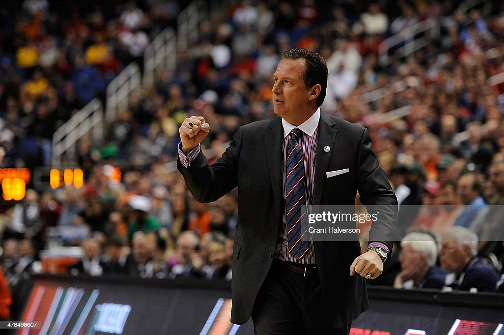 Head coach Mark Gottfried of the North Carolina State Wolfpack reacts during the final minute of a win over the Miami Hurricanes during the second round of the 2014 Men's ACC Basketball Tournament at Greensboro Coliseum on March 13, 2014 in Greensboro, North Carolina.