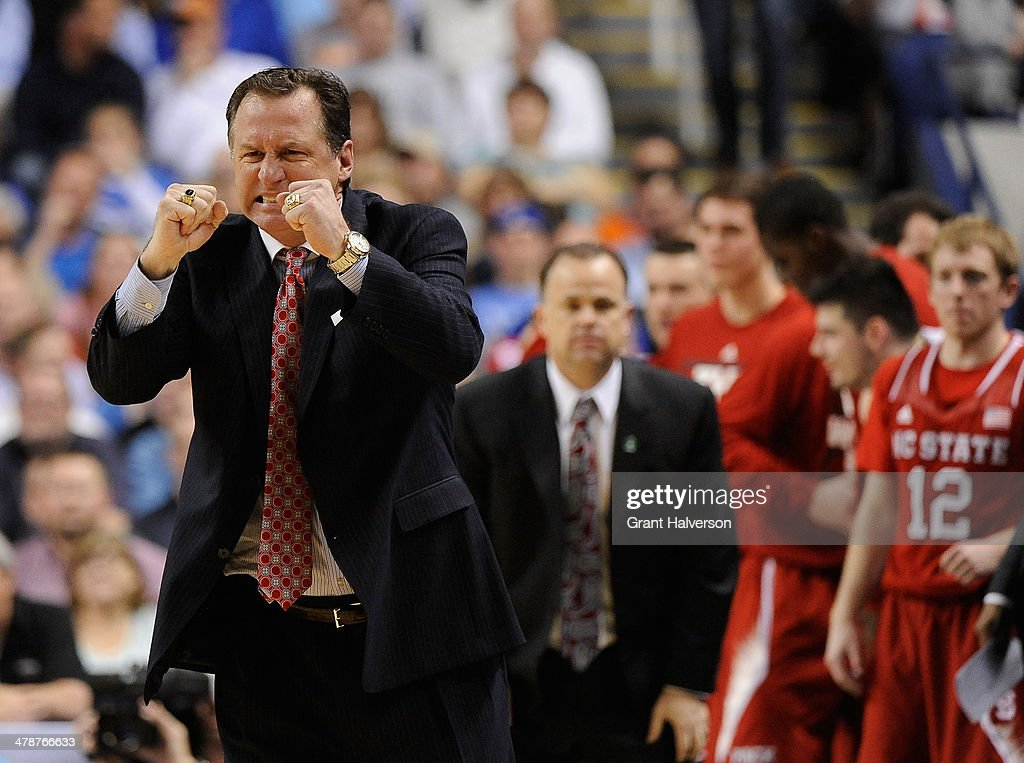 Head coach Mark Gottfried of the North Carolina State Wolfpack reacts in a 66-63 win over the Syracuse Orange during the quarterfinals of the 2014 Men's ACC Basketball Tournament at Greensboro Coliseum on March 14, 2014 in Greensboro, North Carolina.