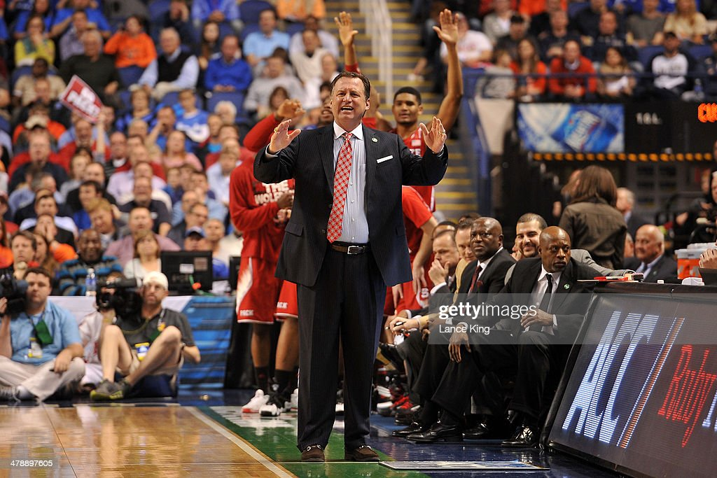 Head Coach Mark Gottfried of the North Carolina State Wolfpack reacts to a play against the Syracuse Orange during the quarterfinals of the 2014 Men's ACC Tournament at the Greensboro Coliseum on March 14, 2014 in Greensboro, North Carolina. NC State defeated Syracuse 66-63.