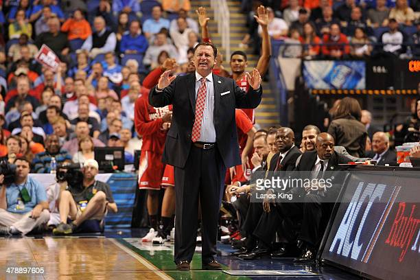 Head Coach Mark Gottfried of the North Carolina State Wolfpack reacts to a play against the Syracuse Orange during the quarterfinals of the 2014...