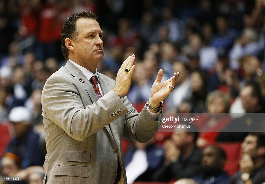 Head coach <a gi-track='captionPersonalityLinkClicked' href=/galleries/search?phrase=Mark+Gottfried&family=editorial&specificpeople=801295 ng-click='$event.stopPropagation()'>Mark Gottfried</a> of the North Carolina State Wolfpack reacts in the second half against the Xavier Musketeers during the first round of the 2014 NCAA Men's Basketball Tournament at at University of Dayton Arena on March 18, 2014 in Dayton, Ohio.