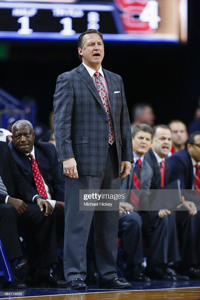 Head coach <a gi-track='captionPersonalityLinkClicked' href=/galleries/search?phrase=Mark+Gottfried&family=editorial&specificpeople=801295 ng-click='$event.stopPropagation()'>Mark Gottfried</a> of the North Carolina State Wolfpack seen on the sidelines during the game against the Notre Dame Fighting Irish at Purcel Pavilion on January 7, 2014 in South Bend, Indiana.