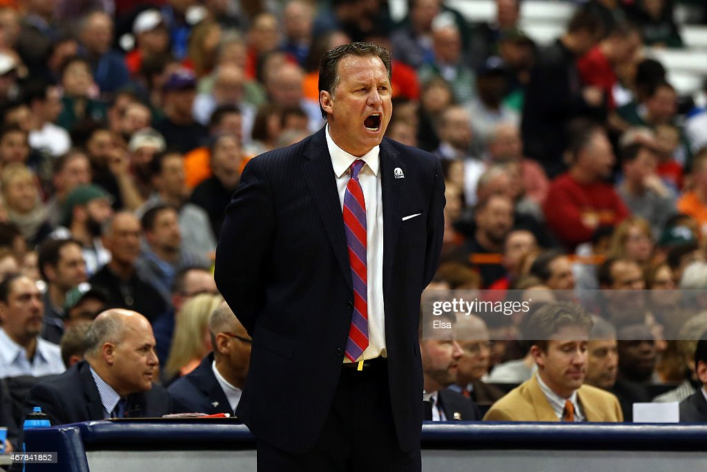 Head coach Mark Gottfried of the North Carolina State Wolfpack shouts against the Louisville Cardinals in the first half of the game during the East Regional Semifinal of the 2015 NCAA Men's Basketball Tournament at the Carrier Dome on March 27, 2015 in Syracuse, New York.