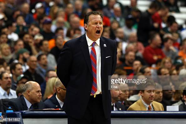 Head coach Mark Gottfried of the North Carolina State Wolfpack shouts against the Louisville Cardinals in the first half of the game during the East...