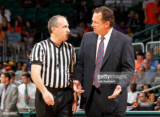 Head coach Mark Gottfried of the North Carolina State Wolfpack talks to a game official after a foul call during first half action against the Miami...