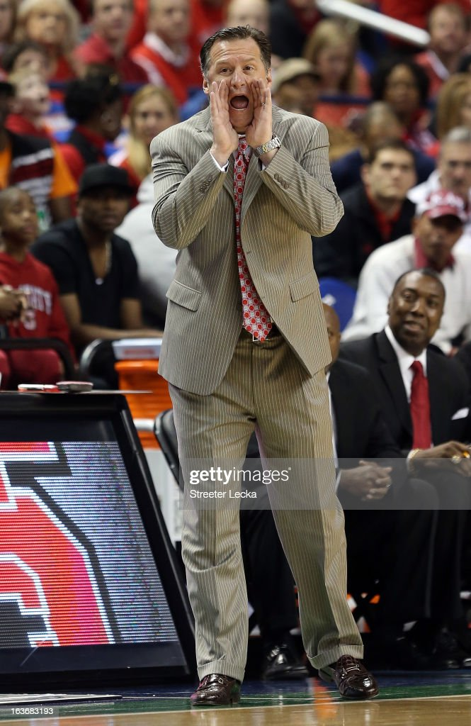 Head coach Mark Gottfried of the North Carolina State Wolfpack yells to his team against the Virginia Tech Hokies during the first round of the Men's ACC Basketball Tournament at Greensboro Coliseum on March 14, 2013 in Greensboro, North Carolina.