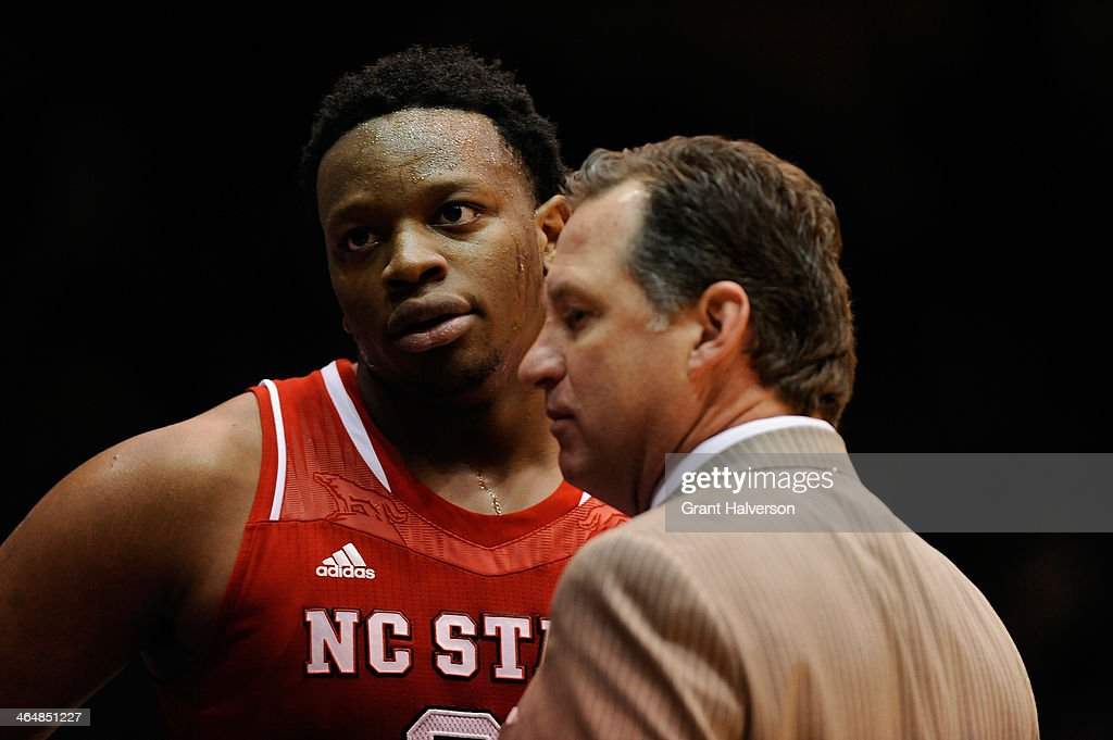 Head coach <a gi-track='captionPersonalityLinkClicked' href=/galleries/search?phrase=Mark+Gottfried&family=editorial&specificpeople=801295 ng-click='$event.stopPropagation()'>Mark Gottfried</a> talks with Beejay Anya #21 of the North Carolina State Wolfpack during their game against the Duke Blue Devils at Cameron Indoor Stadium on January 18, 2014 in Durham, North Carolina. Duke won 95-60.