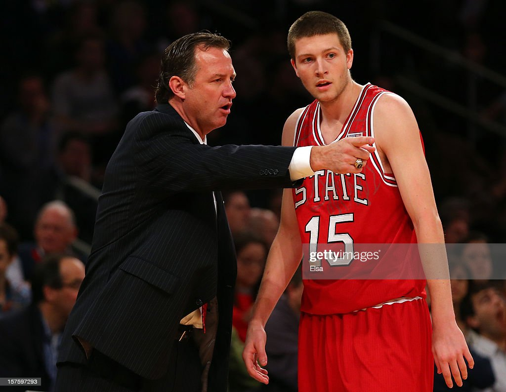 Head coach Mark Gottfried talks with Scott Wood #15 of the North Carolina State Wolfpack during a stop in play in the first half against the Connecticut Huskies during the Jimmy V Classic on December 4, 2012 at Madison Square Garden in New York City.