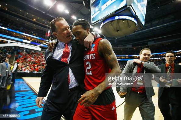 Head coach Mark Gottfried walks off the floor with Anthony Barber of the North Carolina State Wolfpack following their 7168 win over the Villanova...