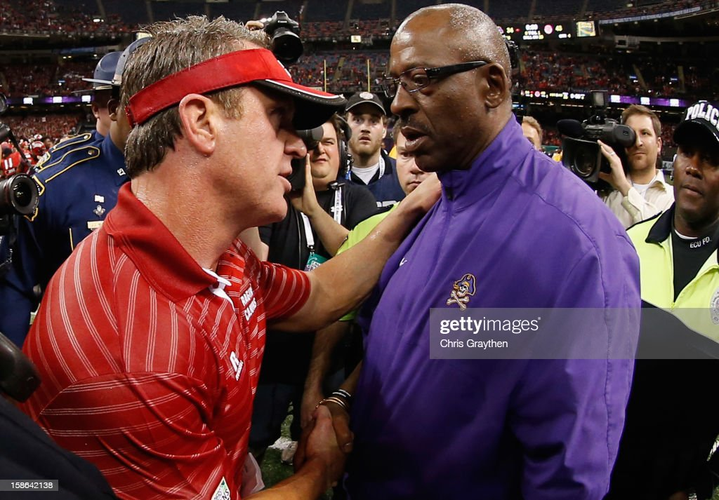 Head coach Mark Hudspeth of the Louisiana-Lafayette Ragin Cajuns talks with head coach Ruffin McNeill of the East Carolina Pirates after the Cajuns defeated the Pirates 43-34 during the R+L Carriers New Orleans Bow at the Mercedes-Benz Superdome on December 22, 2012 in New Orleans, Louisiana.
