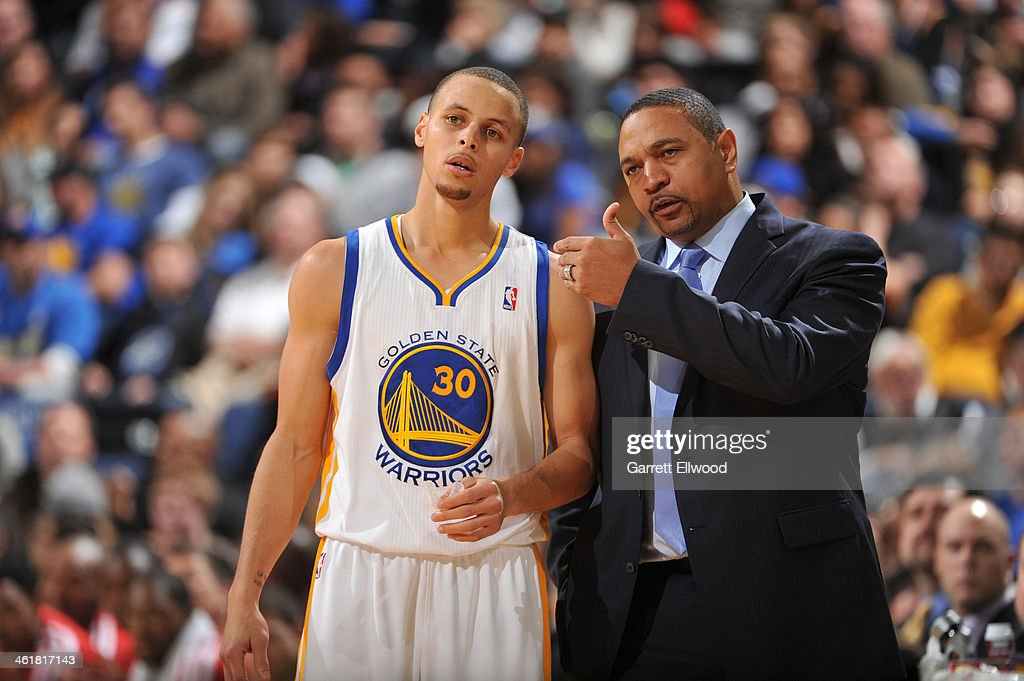 Head Coach Mark Jackson of the Golden State Warriors coaches player Stephen Curry #30 against the Boston Celtics on January 10, 2014 at Oracle Arena in Oakland, California.