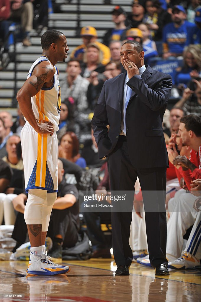 Head Coach Mark Jackson of the Golden State Warriors coaches player <a gi-track='captionPersonalityLinkClicked' href=/galleries/search?phrase=Andre+Iguodala&family=editorial&specificpeople=201980 ng-click='$event.stopPropagation()'>Andre Iguodala</a> #9 against the Boston Celtics on January 10, 2014 at Oracle Arena in Oakland, California.