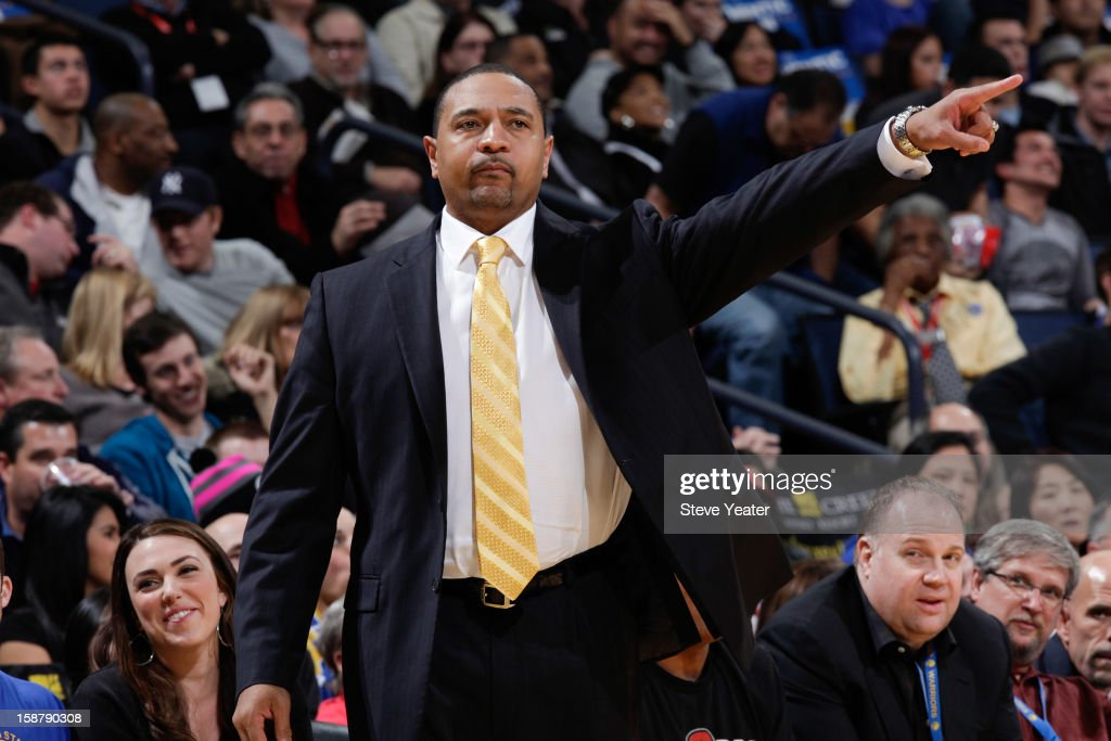 Head coach Mark Jackson of the Golden State Warriors directs his players against the Philadelphia 76ers on December 28, 2012 at Oracle Arena in Oakland, California.
