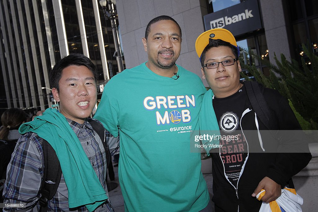 Head Coach Mark Jackson of the Golden State Warriors poses for a photo with fans on October 26, 2012 in Oakland, California.
