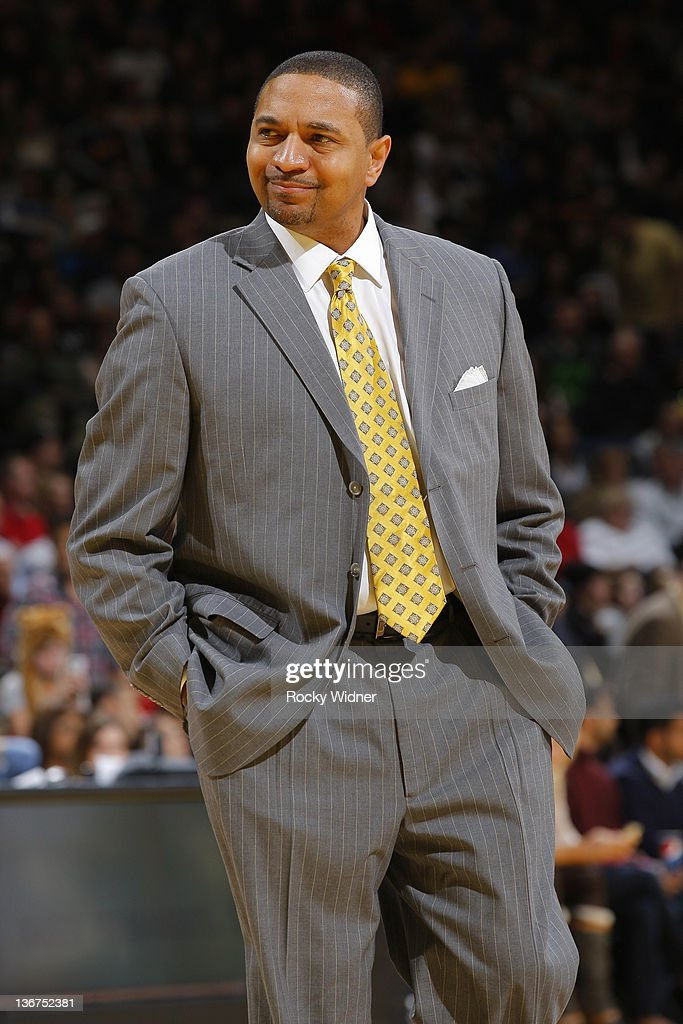 Head Coach Mark Jackson of the Golden State Warriors smiles to the crowd during a game against the Utah Jazz on January 7, 2012 at Oracle Arena in Oakland, California.
