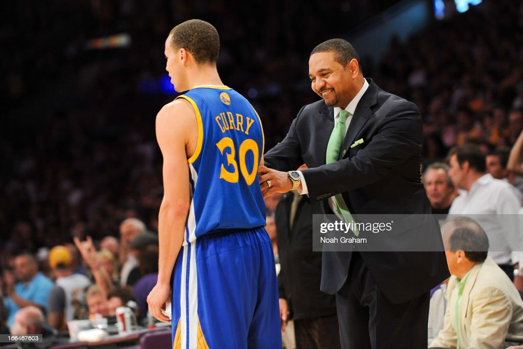 Head Coach Mark Jackson of the Golden State Warriors smiles while talking to Stephen Curry #30 during their game against the Los Angeles Lakers at Staples Center on April 12, 2013 in Los Angeles, California.