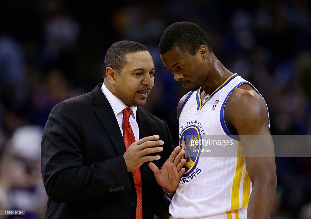 Head coach Mark Jackson of the Golden State Warriors talks to Harrison Barnes #40 during their game against the Los Angeles Clippers at Oracle Arena on January 21, 2013 in Oakland, California.