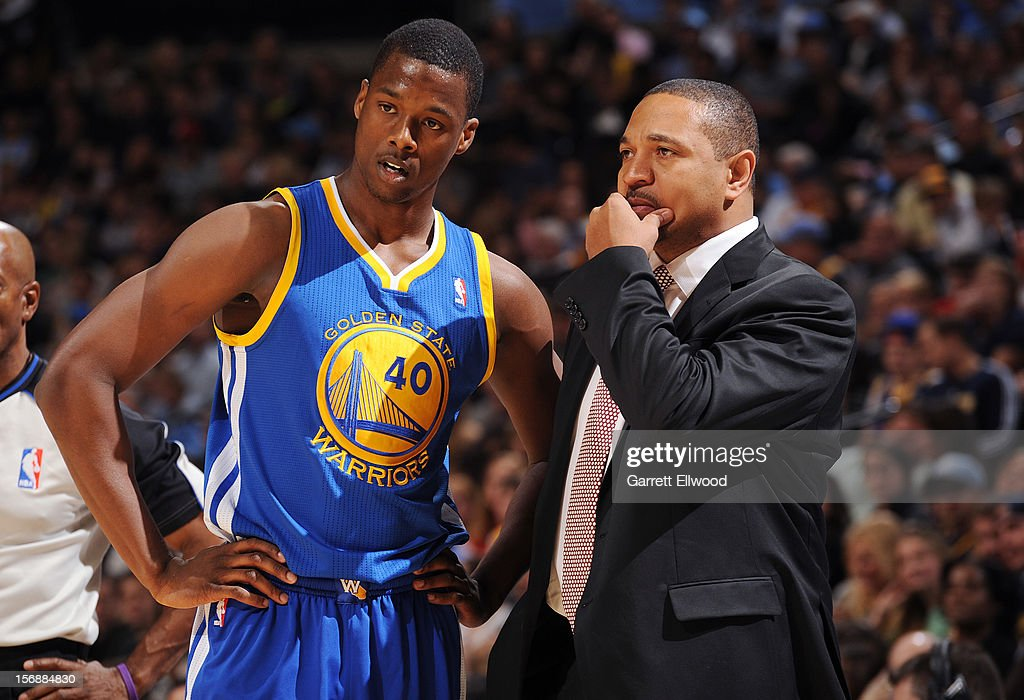 Head Coach Mark Jackson talks with his player Harrison Barnes #40 of the Golden State Warriors during the game against the Denver Nuggets on November 23, 2012 at the Pepsi Center in Denver, Colorado.