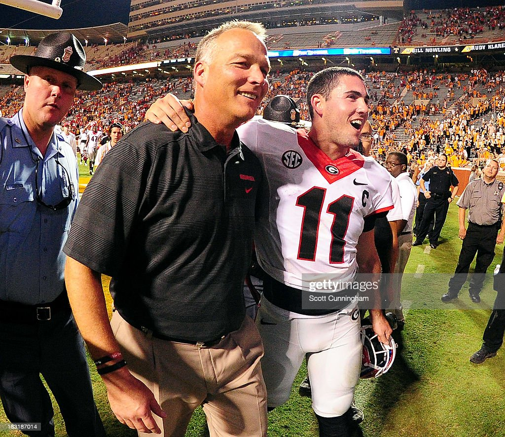 Head Coach <a gi-track='captionPersonalityLinkClicked' href=/galleries/search?phrase=Mark+Richt&family=editorial&specificpeople=2080397 ng-click='$event.stopPropagation()'>Mark Richt</a> and Aaron Murray #11 of the Georgia Bulldogs celebrate after the game against the Tennessee Volunteers at Neyland Stadium on October 5, 2013 in Knoxville, Tennessee.