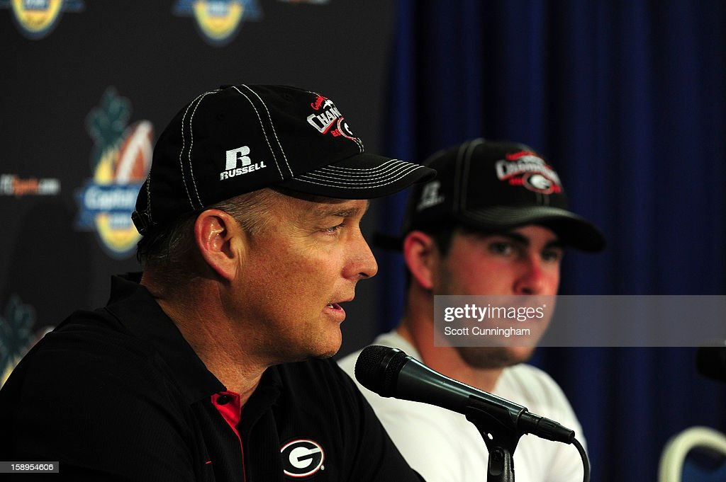 Head Coach Mark Richt and Aaron Murray #11 of the Georgia Bulldogs speak to the media after the Capital One Bowl against the Nebraska Cornhuskers at the Citrus Bowl on January 1, 2013 in Orlando, Florida.