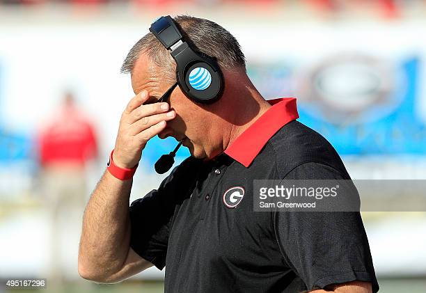 Head coach Mark Richt of the Georgia Bulldogs adjusts his glasses during the game against the Florida Gators at EverBank Field on October 31 2015 in...