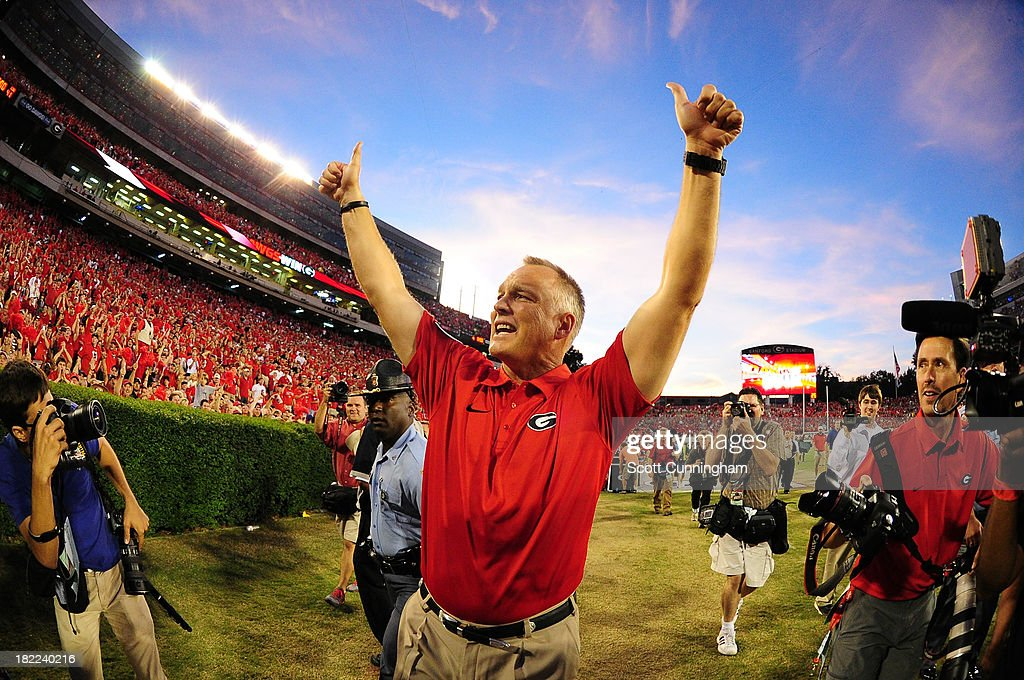 Head Coach <a gi-track='captionPersonalityLinkClicked' href=/galleries/search?phrase=Mark+Richt&family=editorial&specificpeople=2080397 ng-click='$event.stopPropagation()'>Mark Richt</a> of the Georgia Bulldogs celebrates after the game against the LSU Tigers at Sanford Stadium on September 28, 2013 in Athens, Georgia.