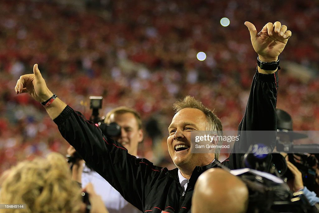 Head coach <a gi-track='captionPersonalityLinkClicked' href=/galleries/search?phrase=Mark+Richt&family=editorial&specificpeople=2080397 ng-click='$event.stopPropagation()'>Mark Richt</a> of the Georgia Bulldogs celebrates following the game against the Florida Gators at EverBank Field on October 27, 2012 in Jacksonville, Florida.