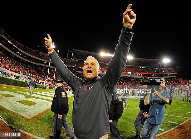 Head Coach Mark Richt of the Georgia Bulldogs celebrates with fans after the game against the Missouri Tigers on October 17 2015 in Atlanta Georgia...