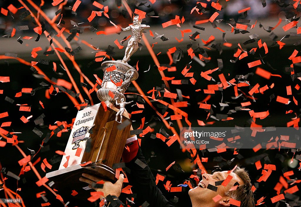 Head coach Mark Richt of the Georgia Bulldogs celebrates with the trophy after their 4110 win against the Hawai'i Warriors during the Allstate Sugar...