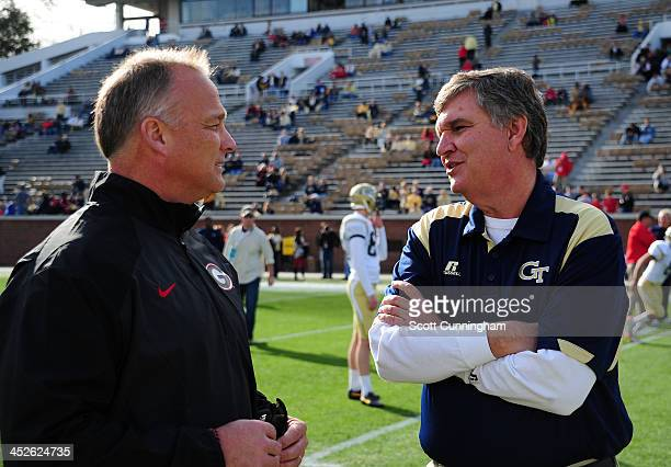 Head Coach Mark Richt of the Georgia Bulldogs chats with Head Coach Paul Johnson of the Georgia Tech Yellow Jackets before the game at Bobby Dodd...