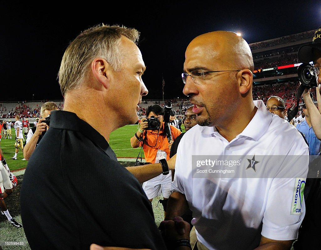 Head Coach <a gi-track='captionPersonalityLinkClicked' href=/galleries/search?phrase=Mark+Richt&family=editorial&specificpeople=2080397 ng-click='$event.stopPropagation()'>Mark Richt</a> (L) of the Georgia Bulldogs is congratulated by Head Coach James Franklin of the Vanderbilt Commodores after the game at Sanford Stadium on September 22, 2012 in Athens, Georgia.