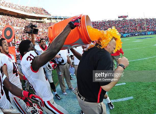 Head Coach Mark Richt of the Georgia Bulldogs is doused with Gatorade by Chris Conley after the Capital One Bowl against the Nebraska Cornhuskers at...