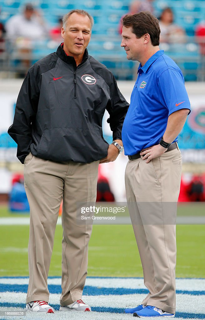 Head coach <a gi-track='captionPersonalityLinkClicked' href=/galleries/search?phrase=Mark+Richt&family=editorial&specificpeople=2080397 ng-click='$event.stopPropagation()'>Mark Richt</a> of the Georgia Bulldogs (L) speaks with head coach <a gi-track='captionPersonalityLinkClicked' href=/galleries/search?phrase=Will+Muschamp&family=editorial&specificpeople=2248036 ng-click='$event.stopPropagation()'>Will Muschamp</a> of the Florida Gators before the game at EverBank Field on November 2, 2013 in Jacksonville, Florida.