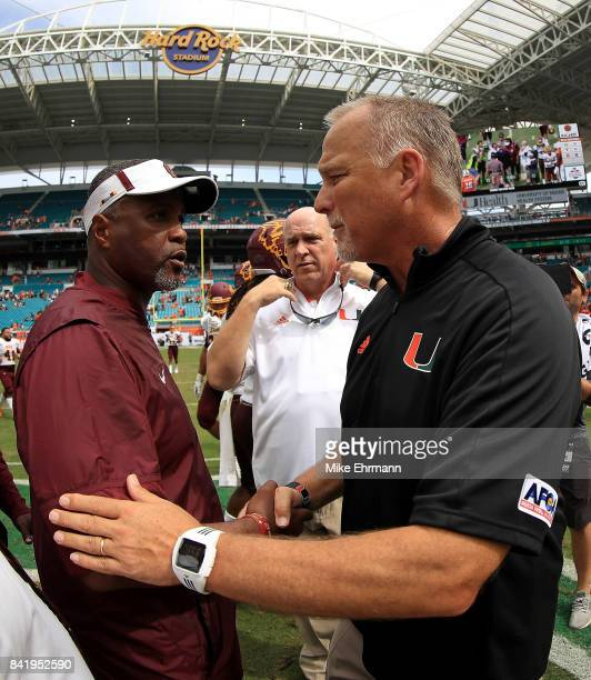 Head coach Mark Richt of the Miami Hurricanes shakes hands with head coach Terry Sims of the Bethune Cookman Wildcats during a game at Hard Rock...