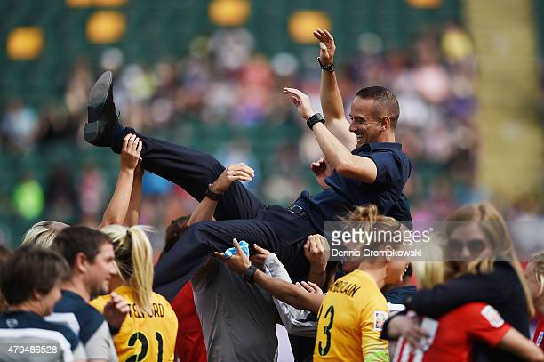 Head coach Mark Sampson of England is thrown in the air as England celebrates their third place in the FIFA Women's World Cup Canada 2015 Third Place...