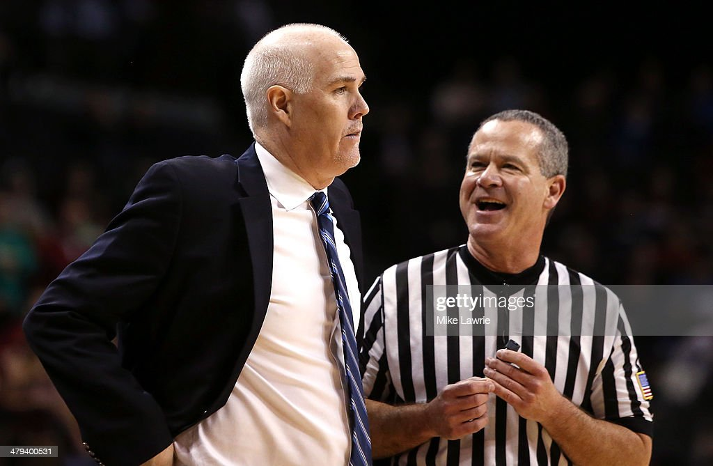 Head coach Mark Schmidt of the St Bonaventure Bonnies speaks to an official in the game against the Saint Joseph's Hawks during the Semifinals of the...