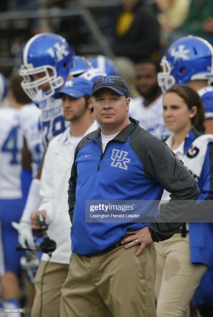 Head Coach Mark Stoops of Kentucky looks at the scoreboard in the final minute of the game against Vanderbilt. The Vanderbilt Commodores defeated the Kentucky Wildcats, 22-6, on Saturday, Nov. 16, 2013, at Vanderbilt Stadium in Nashville, Tenn.